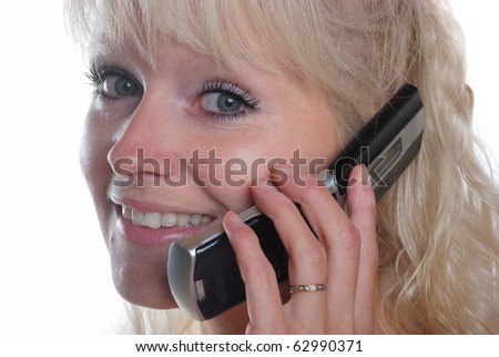 portrait of blond woman phoning