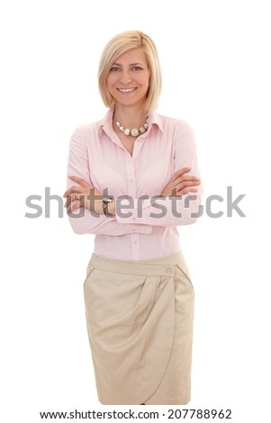 Portrait of blonde, casual businesswoman standing with arms crossed, looking at camera, white background. - stock photo