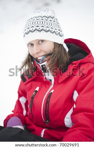portrait of blonde girl in the snow - stock photo