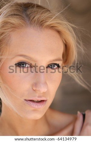 Portrait of blonde model outdoors