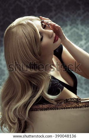 Portrait of blonde woman with long, healthy, straight hair - stock photo