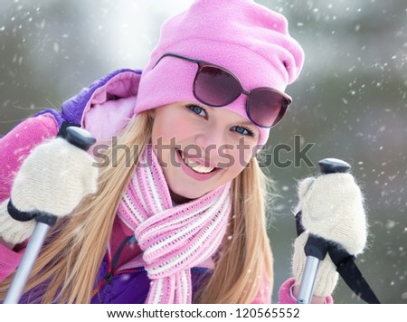 Portrait of blondy young woman with ski in winter time - stock photo
