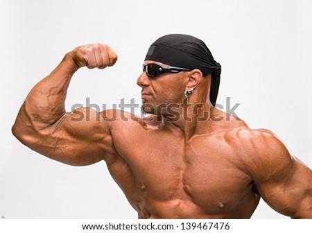 Portrait of bodybuilder on a white background - stock photo