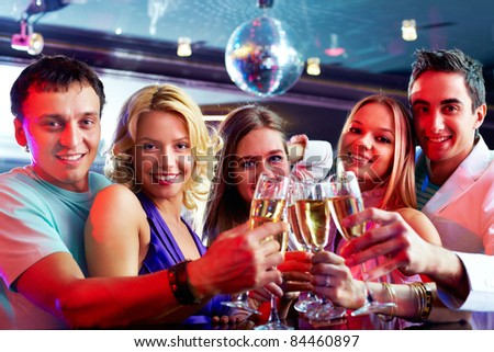 Portrait of boozing people in smart clothes toasting at party - stock photo