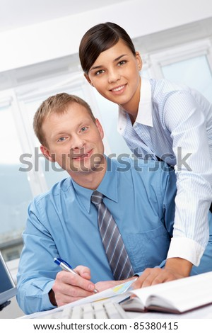 Portrait of boss and his subordinate looking at camera and smiling