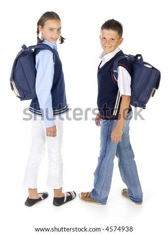 Portrait of boy and girl. They're looking at camera and smiling. Holding backpacks. Isolated on white in studio, side view - stock photo