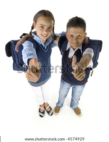Portrait of boy and girl. They're looking at camera and smiling. Thumbs up. Isolated on white in studio, high angle view - stock photo
