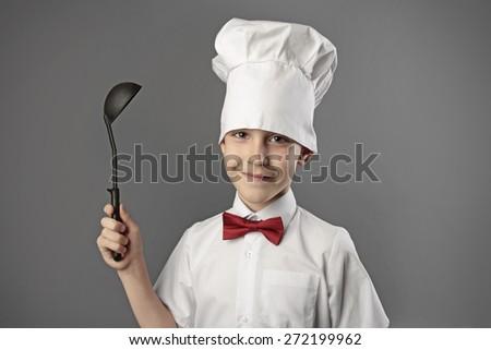 portrait of boy chef - stock photo