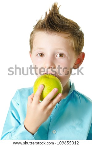 Portrait of Boy eating an apple .