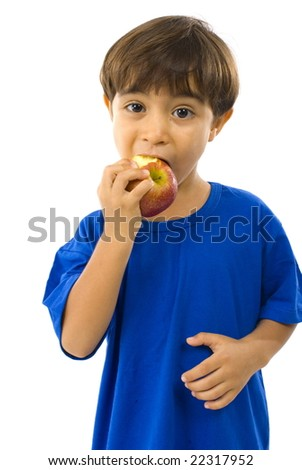 Portrait of Boy eating an apple . - stock photo