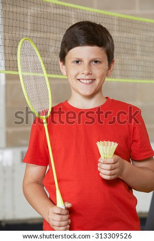 Portrait Of Boy In School Gym Playing Badminton - stock photo