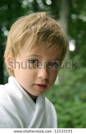 portrait of boy on the green background