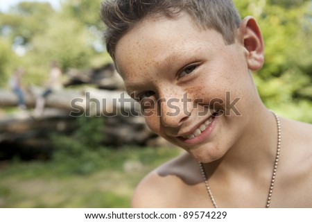 Portrait of boy smiling, close up.