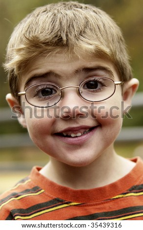 portrait of boy with eyeglasses - stock photo