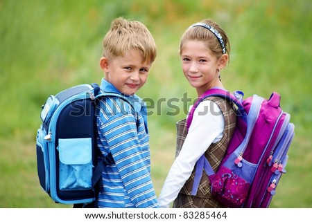 portrait of boy with girl walking to school