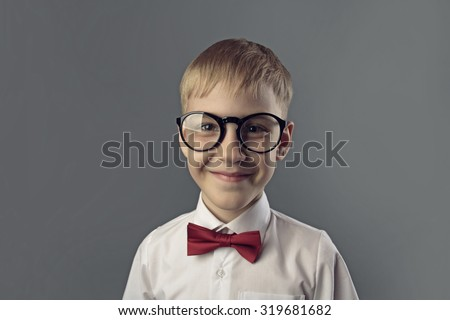 portrait of boy with glasses
