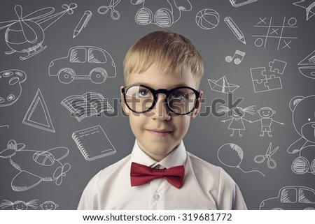 portrait of boy with glasses - stock photo