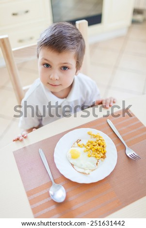 Portrait of boy with his breakfast - stock photo