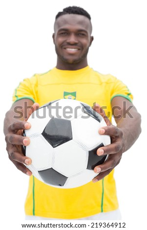 Portrait of Brazilian football player standing over white background