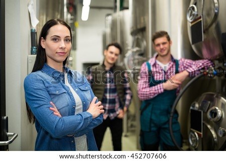Portrait of brewers posing at brewery factory