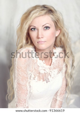 portrait of bride with blond curly hair - stock photo