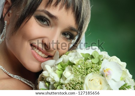 portrait of bride with flowers - stock photo