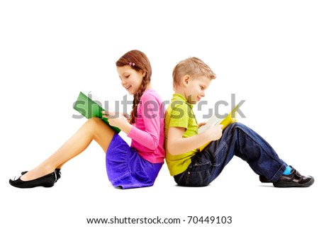 Portrait of brother and sister sitting back to back and reading books - stock photo