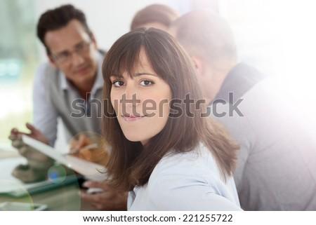 Portrait of brunette girl in office - stock photo