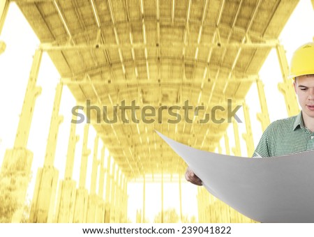 Portrait of builder man wear stripped shirt view of architect looking comparing housing project with building blue print paper plan on texture roof background in perspective Copy space for inscription - stock photo