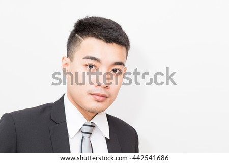 Portrait of business asian smart man on white background - stock photo