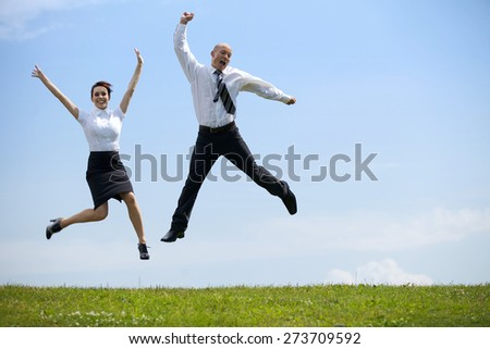 Portrait of business couple enjoying in park - stock photo