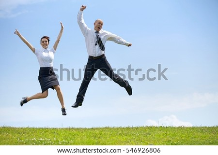 Portrait of business couple enjoying in park