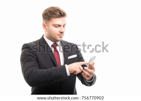 Portrait of business man browsing on smartphone isolated on white background with copyspace advertising area