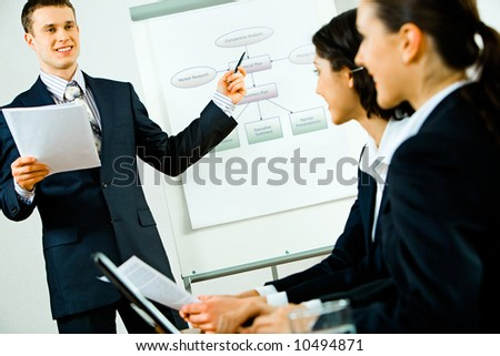 Portrait of business man demonstrating his project and talking - stock photo