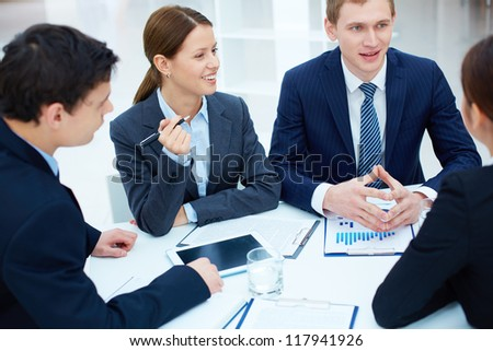 Portrait of business partners discussing new ideas at meeting