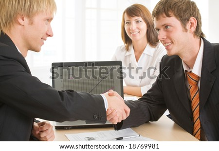 Portrait of business partners shaking hands - stock photo