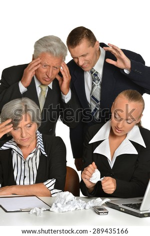 Portrait  of business people at work with laptop - stock photo