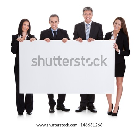 Portrait Of Business People Holding Placard Over White Background - stock photo