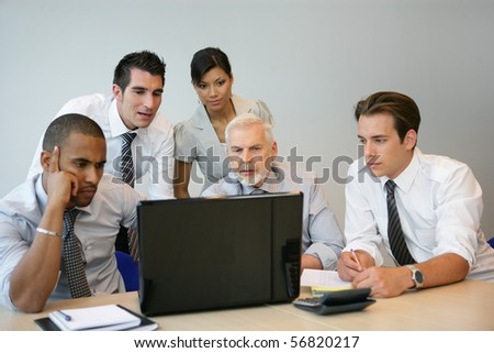 Portrait of business people in a meeting with a laptop computer