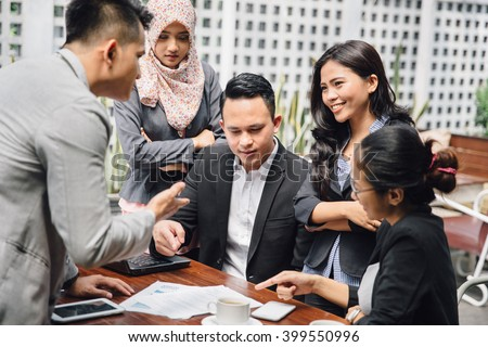portrait of Business people in cafe discussing work at cafe - stock photo