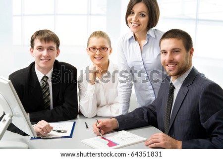 Portrait of business people looking at camera - stock photo