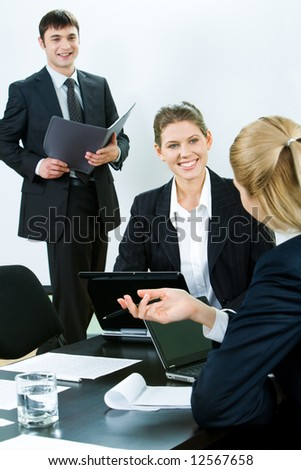 Portrait of business people looking at woman explaining her working ideas