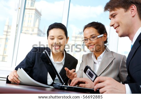 Portrait of business people sharing their ideas about business project - stock photo