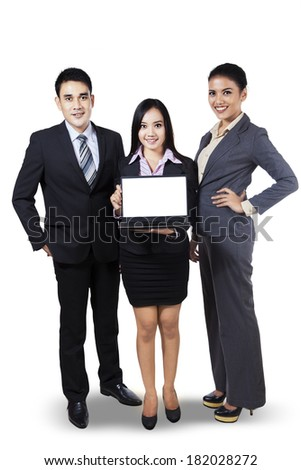Portrait of business people showing copy space on laptop. isolated on white - stock photo