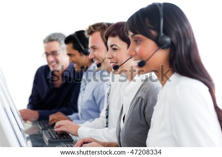 Portrait of business people working in a call center against a white background - stock photo