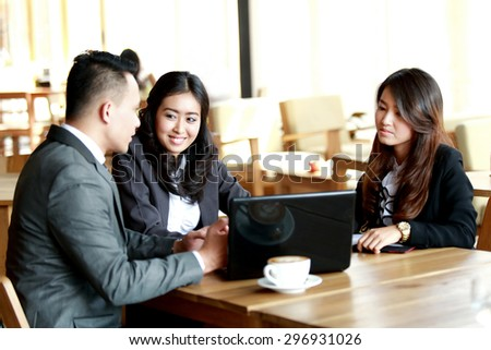 portrait of business presentation on laptop during coffee break at cafe - stock photo