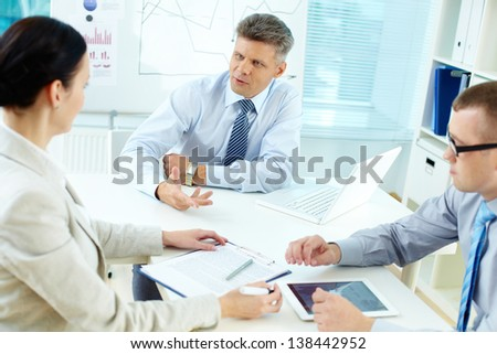 Portrait of business team discussing new project - stock photo