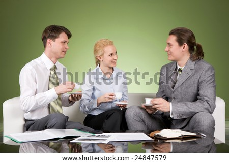 Portrait of business team having coffee break and chatting with each other