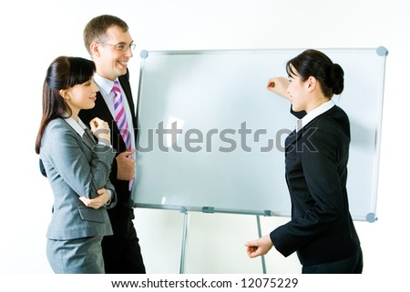 Portrait of business woman explaining her ideas on the whiteboard  at seminar - stock photo