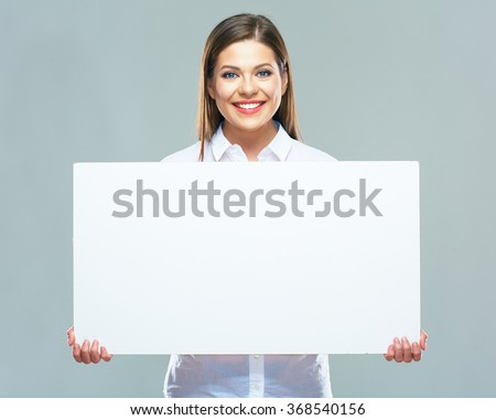 Portrait of business woman holding sign board. Isolated studio background. Smiling model with long hair. Business person.